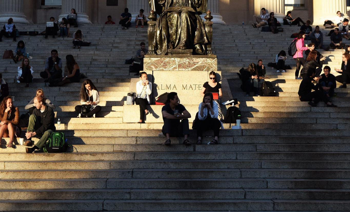 Students sitting at Low Library steps